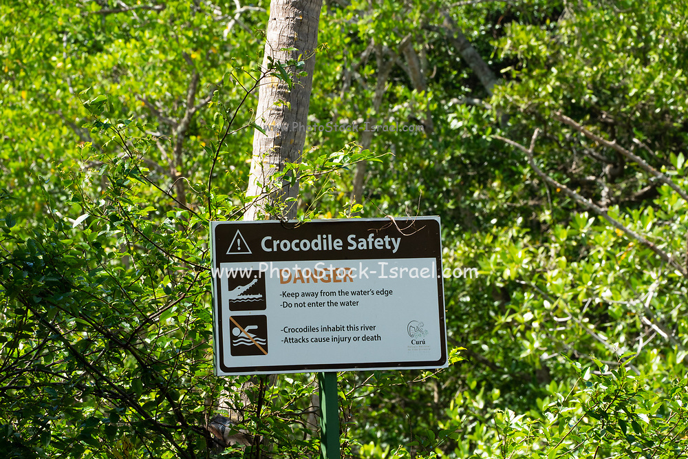 Caiman and crocodile warning sign Photographed in Costa Rica.