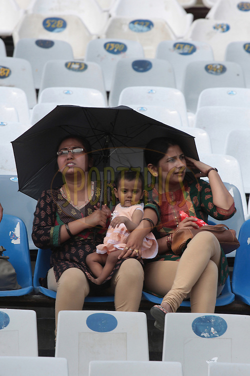 Ladies with a child watching during match 9 of the Indian Premier League ( IPL ) Season 4 between the Kings XI Punjab and the Chennai Super Kings held at the PCA stadium in Mohali, Chandigarh, India on the 13th April 2011..Photo by Anil Dayal/BCCI/SPORTZPICS