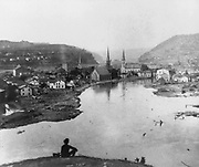 Johnstown disaster, May 31, 1889. Conemaugh Valley. photographic print on stereo card : stereograph. Man seated on hill in foreground after the floods in Johnstown Pennsylvania,1880-1890.
