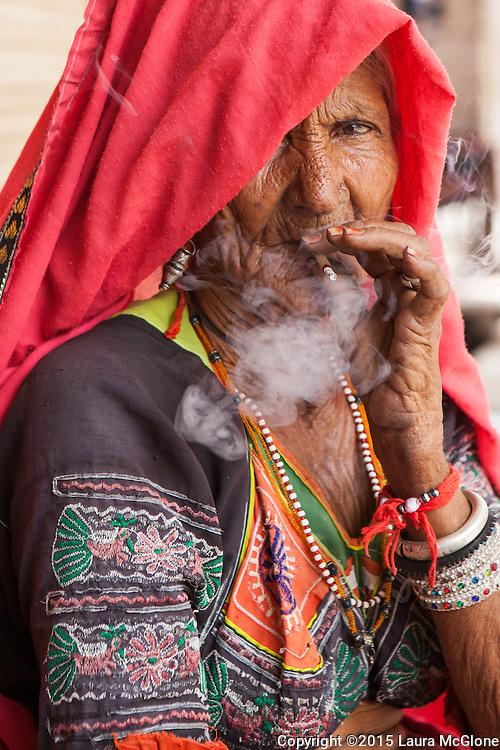 India - Pushkar Tribal Woman smoking