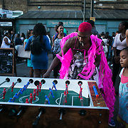 Fun and games in Ridley Road, post carnival. Hackney carnival 2016 took place on a hot Indian summer's day, September 2016 with the streets full of partying people.