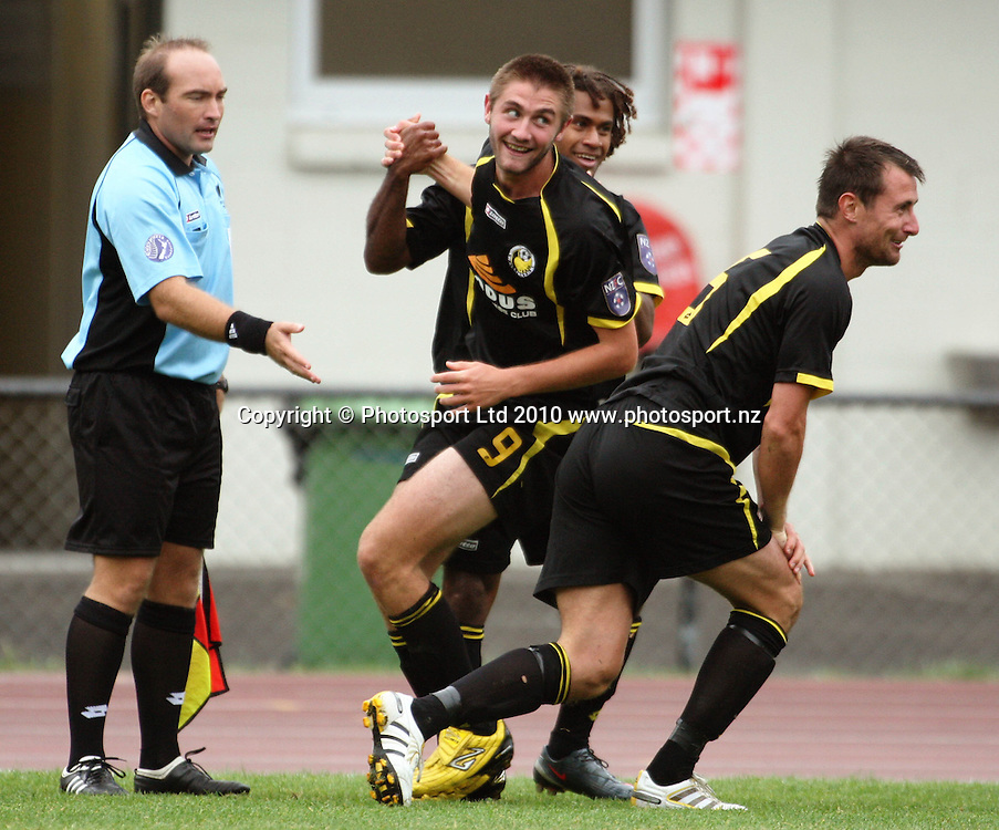 Wellington's Michael Fifii and Chris Davies congratulate Greg Draper on his second goal in the 3-2 win.<br /> NZFC soccer  - Team Wellington v Waitakere United at Newtown Park, Wellington. Sunday, 4 April 2010. Photo: Dave Lintott/PHOTOSPORT
