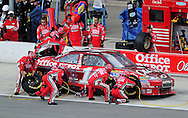 Feb. 21, 2010; Fontana, CA, USA; NASCAR Sprint Cup Series driver Tony Stewart pits during the Auto Club 500 at Auto Club Speedway. Mandatory Credit: Jennifer Stewart-US PRESSWIRE