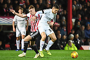 Middlesbrough Midfielder Mo Besic (37) and Brentford Midfielder Lewis Macleod (4) during the EFL Sky Bet Championship match between Brentford and Middlesbrough at Griffin Park, London, England on 24 November 2018.