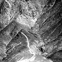 A road leads up a mountain, consists of several ridges.
