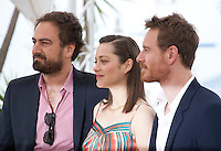 Director Justin Kurzel, actress Marion Cotillard and actor Michael Fassbender at the Macbeth film photo call at the 68th Cannes Film Festival Saturday 23rd May 2015, Cannes, France.