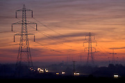 Electricity pylons over a motorway near Burbage, Leicestershire, United Kingdom
