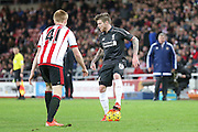Liverpool defender Alberto Moreno  takes on Sunderland midfielder Duncan Watmore during the Barclays Premier League match between Sunderland and Liverpool at the Stadium Of Light, Sunderland, England on 30 December 2015. Photo by Simon Davies.