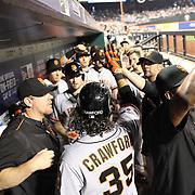 Brandon Crawford,  San Francisco Giants, is congratulated by team mates after hitting a home run during the New York Mets Vs San Francisco Giants MLB regular season baseball game at Citi Field, Queens, New York. USA. 11th June 2015. Photo Tim Clayton