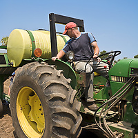 John Deere tractor with an irrigation tank and transplanter.