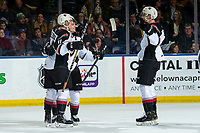KELOWNA, BC - DECEMBER 18:  Tyler Preziuso #11, Tristen Nielsen #8 and Trevor Longo #4 of the Vancouver Giants celebrate a third period goal against the Kelowna Rockets at Prospera Place on December 18, 2019 in Kelowna, Canada. (Photo by Marissa Baecker/Shoot the Breeze)