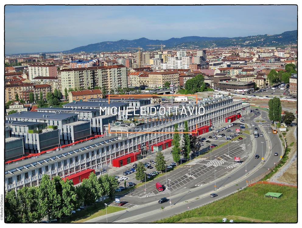 Torino spina 3 SNOS GALLERY CENTRE Centro Commerciale in Corso Mortara, 24, lo stabilimento della Ex Savigliano trasformato in centro commerciale e uffici.