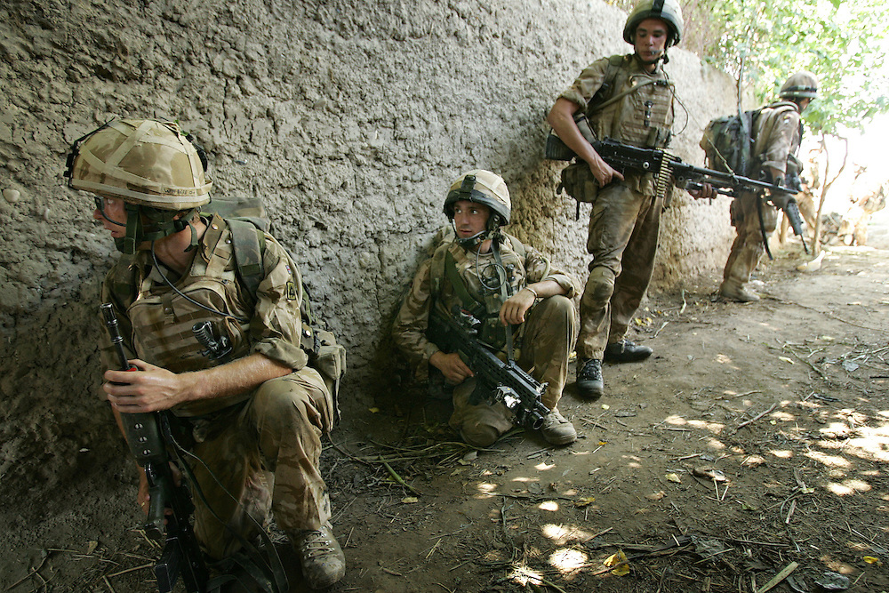 29/06/07..Sangin Valley, Helmand, Afghanistan..Soldiers from A Company 1 Battalion Royal Anglians, known as 'The Vikings' prepare to enter a compound whilst conducting operations against the Taliban in the Sangin Valley, Helmand province, Afghanistan on the 29th June 2007...The soldiers made a Tactical Advance to Battle over night carrying just food, water and ammunition. At first light they moved on their objectives; a series of compounds, orchards and paddy fields. During the day they exchanged fire with the enemy on a number of occasions. 13 Taliban were killed, 1 British soldier and 3 Afghan troops were wounded.