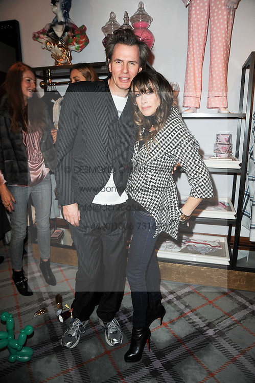 JOHN TAYLOR and GELA NASH-TAYLOR at the Juicy Couture children's tea party in aid of Mothers 4 Children held at the Juicy Couture Store, Bruton Street, London on2nd December 2009.