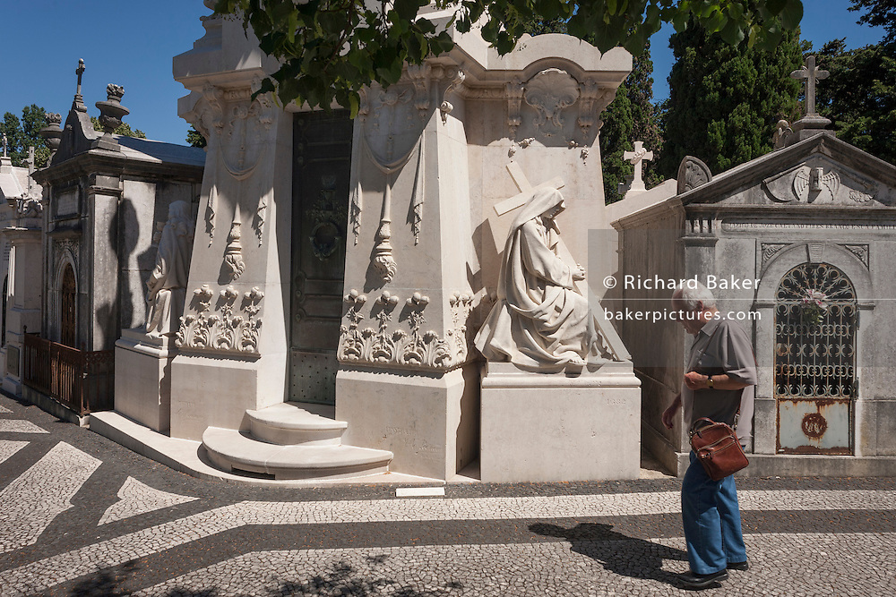 Individual tombs and family mausoleums, on 14th July 2016, at Prazeres Cemetery, Lisbon, Portugal. Prazeres Cemetery (Cemitério dos Prazeres) is the largest cemetery in Lisbon, Portugal, located in the west part of the city in the former Prazeres parish. It was created in 1833 after the outbreak of a cholera epidemic. Many famous Portuguese citizens are buried here, including artists, authors and government figures, and the cemetery features many large mausoleums built in the 19th century. (Photo by Richard Baker / In Pictures via Getty Images)
