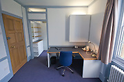 Study bedroom showing desk and storage area