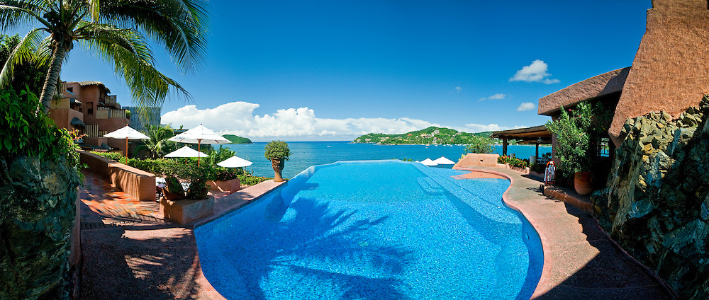 La Casa Que Canta, a luxury resort on the cliffs of Zihuatanejo overlooking the bay. High resolution panorama. The resort has two pools--this is the fresh water one. The restaurant is at right.