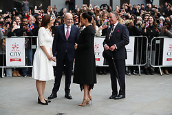 Dr Charles Goodson-Wickes (right), the Representative Deputy Lieutenant for Islington, watches as The Duchess of Sussex talks with Dr Joanna Newman, the Chief Executive of ACU and Professor Sir Paul Curran, President of City University, as she arrives for a visit to the Association of Commonwealth Universities at the University of London.