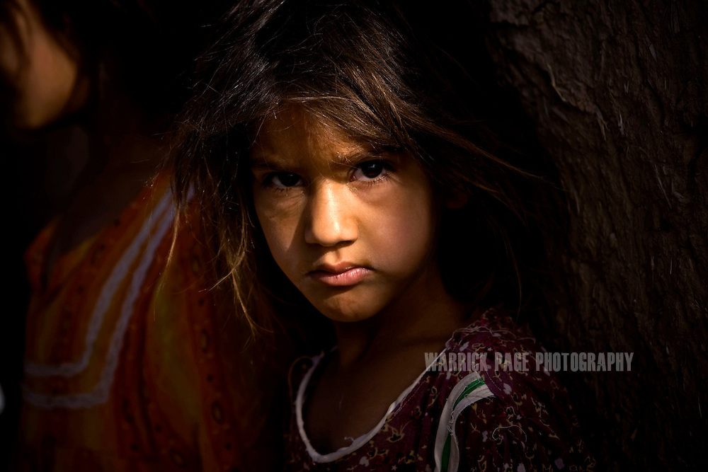 UMAR MANDAN, IRAQ - JUNE 13: An Iraqi girl is seen outside her home, on June 13, 2010, in Umar Mandan, in Diyala Province, Iraq. Iraq faces multiple challenges in the lead-up to the drawn-down of US forces in Iraq, with many observers claiming that while they have the capablities of handling home-grown problems, they are far from being able to tackle external threats. Political wrangling has reportedly fostered greater instability throughout the country with fears of renewed sectarian violence breaking out as insurgents set-up attacks in an attempt to exploit vulnerabilities amongst the populace. (Photo by Warrick Page)