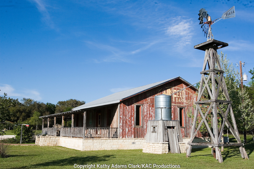 Outside Sisterdale, Texas, you'll find A Feed Bar LLC, with a Texas-style  windmill.