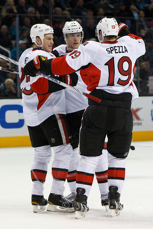 Jan 19, 2012; San Jose, CA, USA; Ottawa Senators left wing Colin Greening (14) is congratulated by right wing Chris Neil (left) and center Jason Spezza (19) after scoring a goal against the San Jose Sharks during the second period at HP Pavilion. Mandatory Credit: Jason O. Watson-US PRESSWIRE