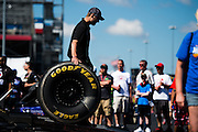 April 22-24, 2016: NHRA 4 Wide Nationals: A mechanic takes tires off a hauler