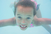 Aubrielle Gibson cools off in the pool following the 70th Anniversary celebration of the Kiwanis Pool in St. Johnsbury Vermont.  Karen Bobotas / for Kiwanis International