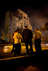 © Licensed to London News Pictures 20/11/2012.  Rishon Lezion, Israel.  A group of Israeli men view the damage to an apartment building which was hit by a rocket.  The city, which sits below Tel Aviv has never been hit before.  The rocket ? said to be carrying 90 kilograms of explosives ? penetrated through three floors of the building, causing extensive damage, but no serious injuries as all of the residents were in their safe rooms.  Photo credit : Alison Baskerville/LNP