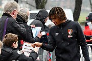 Nathan Ake (5) of AFC Bournemouth signs his autograph for a young fan as he arrives at the Vitality Stadium as light snow falls before the Premier League match between Bournemouth and West Bromwich Albion at the Vitality Stadium, Bournemouth, England on 17 March 2018. Picture by Graham Hunt.