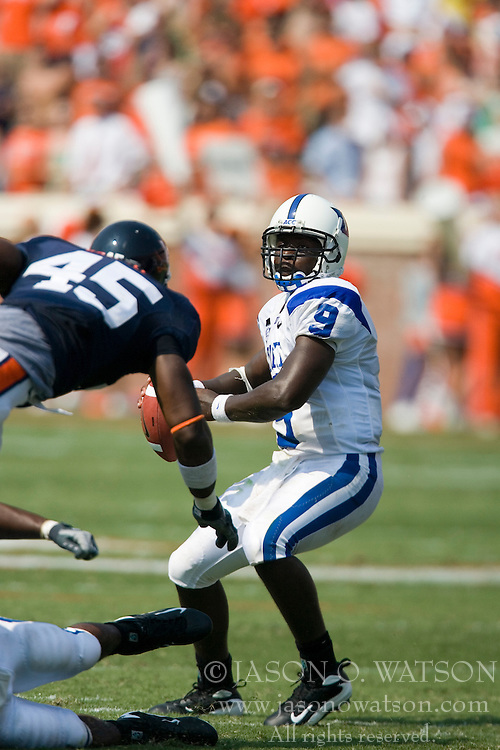 Virginia linebacker Denzel Burrell (45) puts pressure on Duke quarterback Thaddeus Lewis (9).  The Virginia Cavaliers defeated the Duke Blue Devils 23-14 at Scott Stadium in Charlottesville, VA on September 8, 2007  With the loss, Duke extended their longest-in-the-nation losing streak to 22 games.