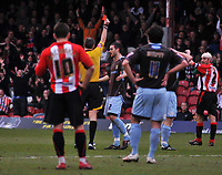 Photo: Tony Oudot/Richard Lane Photography. Brentford v Bury . Coca-Cola Football League Two. 28/02/2009. <br /> Paul Scott of Bury is sent off by referee P Crossley for kicking the ball away
