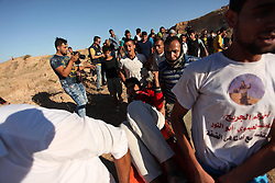 September 30, 2016 - Bureij, Gaza Strip, Palestinian Territory - Palestinian protesters carry a wounded comrade during clashes with Israeli security forces near the border between Israel and Central Gaza Strip east of Bureij on Sep. 30, 2016  (Credit Image: © Ashraf Amra/APA Images via ZUMA Wire)