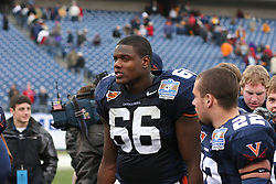 Virginia left tackle D'Brickashaw Ferguson (66) celebrates with teammates after winning the Music City Bowl.  The Virginia Cavaliers defeated the Minnesota Golden Gophers 34-31 at the Music City Bowl in Nashville, TN on December 30, 2005.