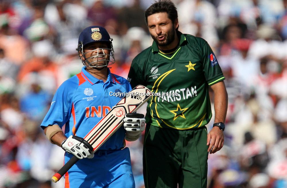 Pakistan captain Shahid Afridi and Indian batsman Sachin Tendulkar during the ICC Cricket World Cup - 2nd Semi-Final  India vs Pakistan Played at Punjab Cricket Association Stadium, Mohali, Chandigarh<br /> 30 March 2011 - day/night (50-over match)