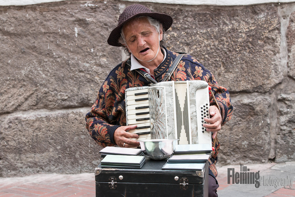 A blind street musician singing with passion in Old Town Quito, Ecuador.