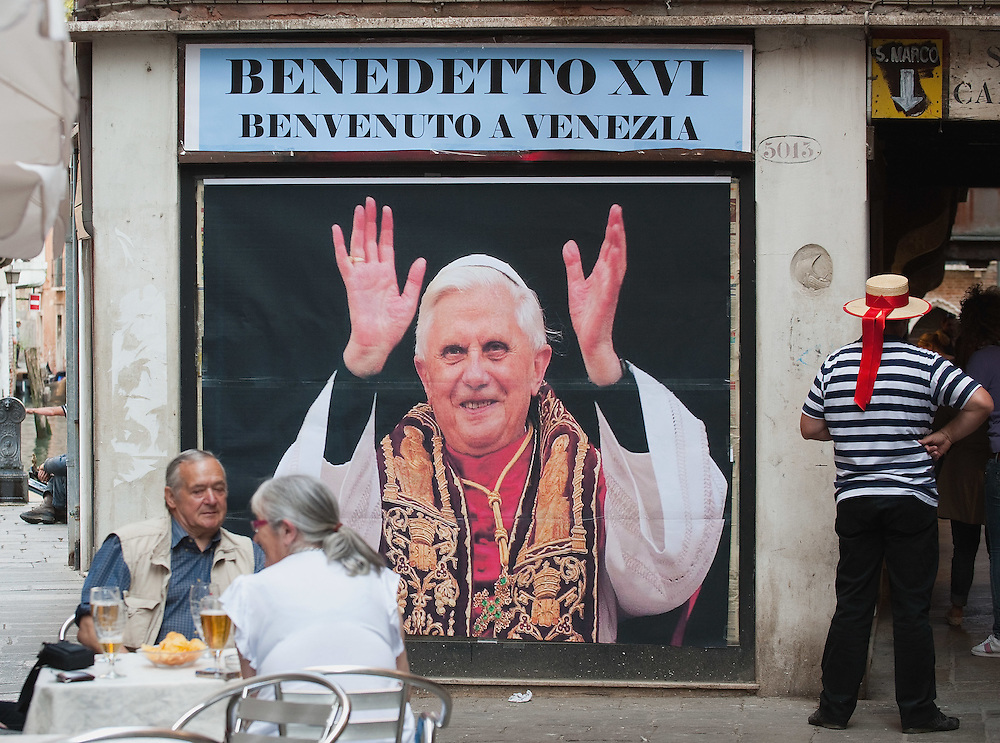 VENICE, ITALY - MAY 07: A gondolier stands in front of a sign that welcomes Pope Benedict XVI on the day of welcoming ceremony in St Mark's Square on May 7, 2011 in Venice, Italy. Pope Benedict XVI will visit Venice on May 7-8, which is 26 years since Pope John Paul II visited  (Photo by Marco Secchi/Getty Images)