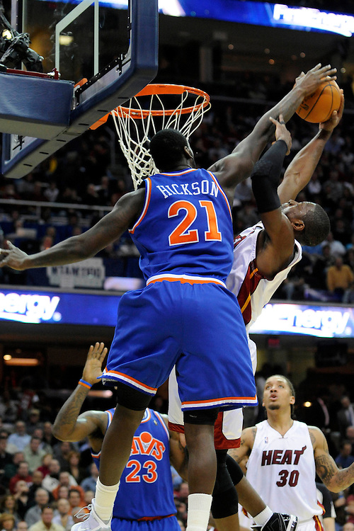 Feb 4, 2010; Cleveland, OH, USA; Cleveland Cavaliers forward J.J. Hickson (21) blocks Miami Heat guard Dwyane Wade (3) during the third quarter at Quicken Loans Arena. The Cavaliers beat the Heat 102-86. Mandatory Credit: Jason Miller-US PRESSWIRE