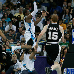 29 March 2009: New Orleans Hornets guard Chris Paul (3) shoots over San Antonio Spurs forward Matt Bonner (15) during a 90-86 victory by the New Orleans Hornets over Southwestern Division rivals the San Antonio Spurs at the New Orleans Arena in New Orleans, Louisiana.