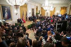 President Donald J. Trump delivers remarks at a Medal of Freedom ceremony Friday, Nov. 16, 2018, in the East Room of the White House. First Lady Melania Trump attends.   (Official White House Photo by Amy Rossetti)