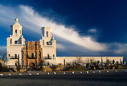 Mission San Xavier del Bac. Front view of the mission, wispy clouds in background, Tucson, Arizona..Subject photograph(s) are copyright Edward McCain. All rights are reserved except those specifically granted by Edward McCain in writing prior to publication...McCain Photography.211 S 4th Avenue.Tucson, AZ 85701-2103.(520) 623-1998.mobile: (520) 990-0999.fax: (520) 623-1190.http://www.mccainphoto.com.edward@mccainphoto.com.