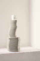 Stack of plates and cups on table