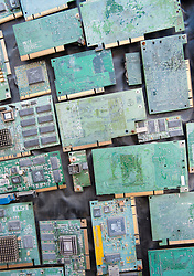 Many old electronic circuit boards from old computers