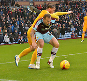 Burnley Midfielder, Scott Arfield impedes Preston North End Forward, Joe Garner  during the Sky Bet Championship match between Burnley and Preston North End at Turf Moor, Burnley, England on 5 December 2015. Photo by Mark Pollitt.