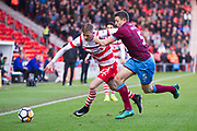 Scunthorpe United defender Murray Wallace (5) battles with Doncaster Rovers Forward Alfie Beestin (22) during the The FA Cup match between Doncaster Rovers and Scunthorpe United at the Keepmoat Stadium, Doncaster, England on 3 December 2017. Photo by Craig Zadoroznyj.
