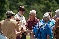 Folks are greeted by Dexter Willson as they arrive for the 70th Anniversary celebration of the Kiwanis Pool in St. Johnsbury Vermont.  Karen Bobotas / for Kiwanis International