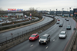 © Licensed to London News Pictures. 17/12/2017. London, UK. A section of the A406 North Circular in Brent, North London which was closed earlier this morning after a white Maserati car collided with two police officers while they were returning to their vehicle. Both police offers are currently in critical condition. Photo credit: Ben Cawthra/LNP