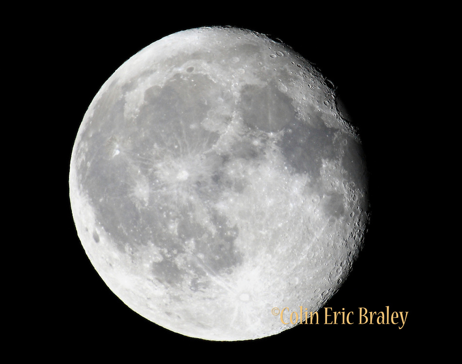 Craters on the moon are more defined as the angle of the sunlight brings out their edges. Photo by Colin Braley
