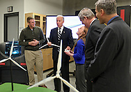 Vice President Joe Biden takes with Iowa State students Jared Juel (left) and Shannon Krogmeier (right) as he tours the Make to Innovate lab at Iowa State University in Ames, Iowa on Thursday, March 1, 2012.