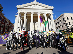 09 February 2016. New Orleans, Louisiana.<br /> Mardi Gras Day. Walking with Skeletons. The Skeleton Krewe stop briefly outside Gallier hall. The Krewe meets before sunrise and walk 5 miles from Uptown, making their way along St Charles Avenue and into the French Quarter where they celebrate Mardi Gras Day.<br /> Photo©; Charlie Varley/varleypix.com