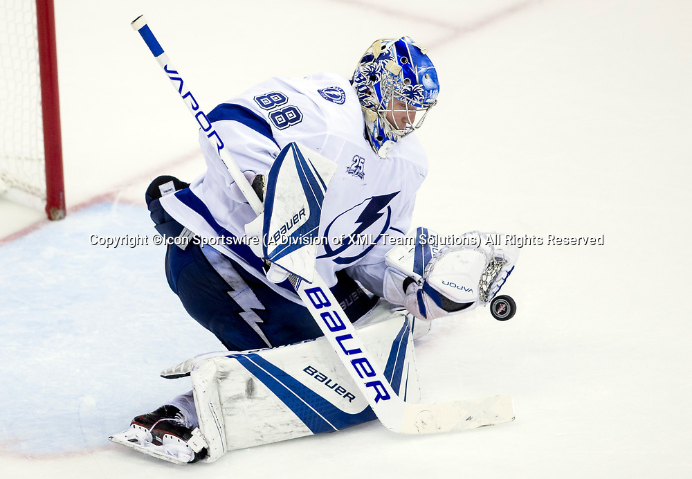 WASHINGTON, DC - MAY 21: Tampa Bay Lightning goaltender Andrei Vasilevskiy (88) blocks a shot in the third period during game 6 of the NHL Eastern Conference  Finals between the Washington Capitals and the Tampa Bay Lightning, on May 21, 2018, at Capital One Arena, in Washington D.C. The Caps defeated the Lightning 3-0<br /> (Photo by Tony Quinn/Icon Sportswire)